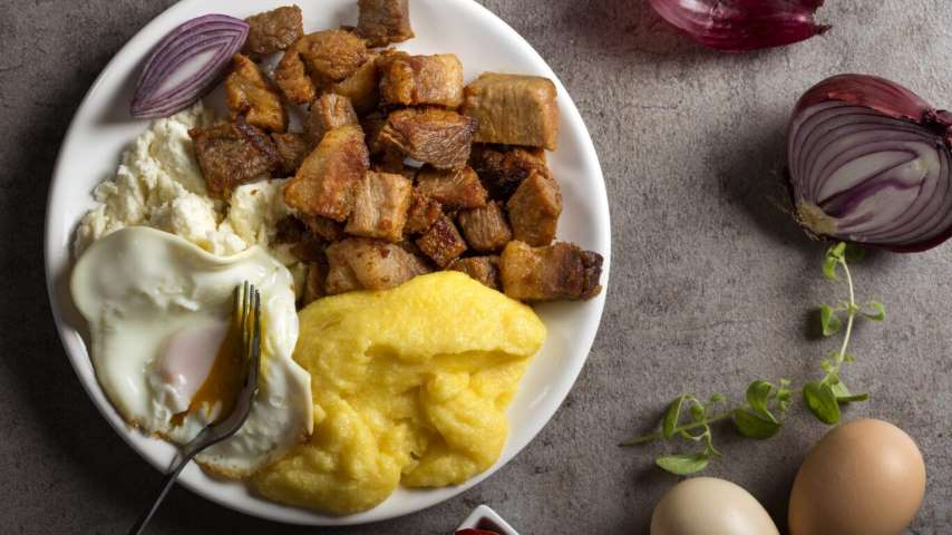"Traditional Romanian food ""Tochitura Moldoveneasca"" made with po"