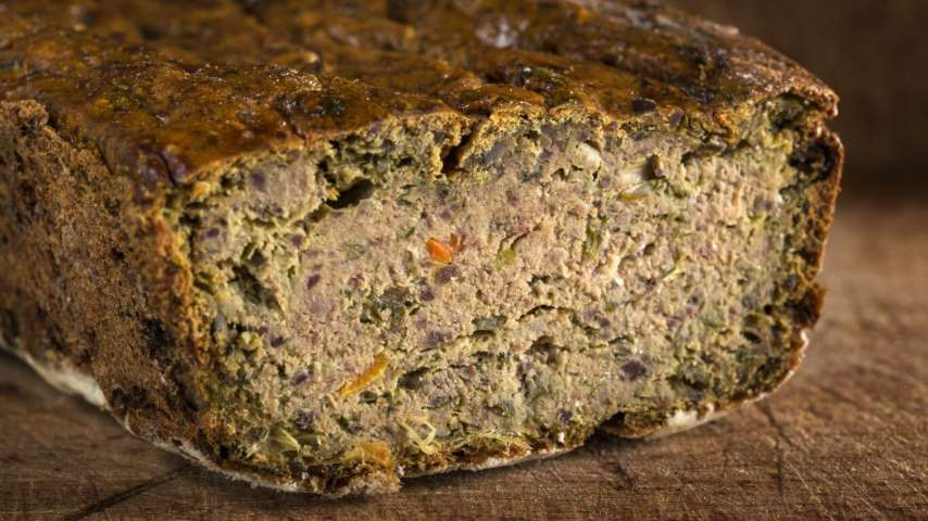 Romanian traditional food called Drob made from meatloaf on wood